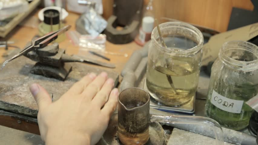 Jeweler restores wedding ring expands the size and makes cleaning and restoration | Shutterstock HD Video #5976488