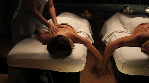 tracking shot of couple getting massage in spa