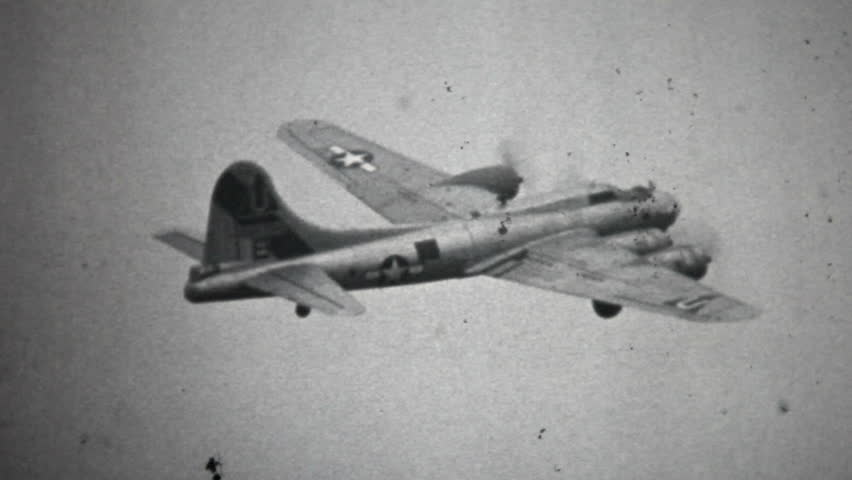 Digital copy of an old black and white film of a Boeing Flying Fortress B17 World War II bomber aircraft of the USAF taking off, flying and landing.