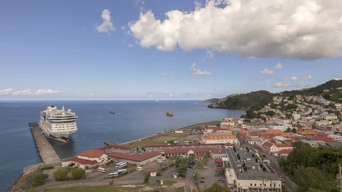 SAINT GEORGE, GRENADA - DEC 2012: Time lapse Panorama of Saint George's harbor on Grenada Island with cruise ship by the jetty on December 16, 2012 in St George, Grenada
