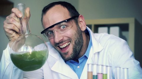 Crazy, mad scientist laughing in laboratory, super slow motion, shot at 240fps