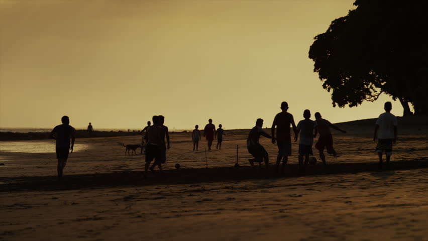 Slow motion, medium shot of people playing outdoors at night / Esterillos Beach, Costa Rica