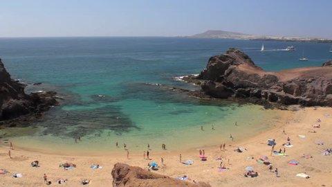 Crystal-clear waters at a horseshoe bay at Papagayo beach, Lanzarote, Canary Islands