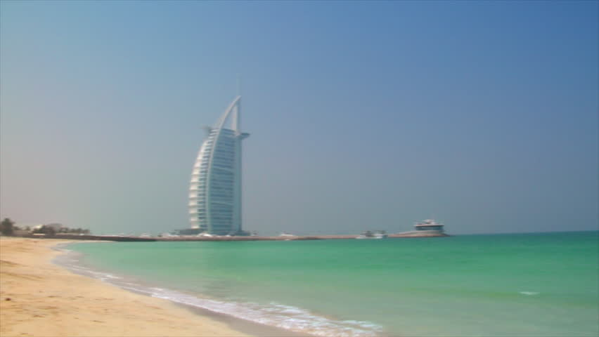 DUBAI - SEPTEMBER 9: A pan shot shows Jumeirah Beach with the famous Burj al Arab Hotel, the Jumeirah Beach  on September 9.2009, Dubai, UAE.