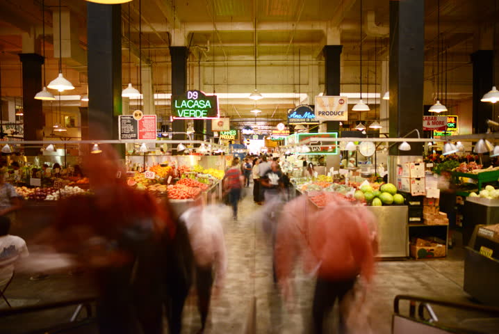 LOS ANGELES, California - April 9th: 4K Full Frame time lapse Photography of unrecognizable shoppers gather at historic Grand Central Market in Downtown Los Angeles on April 9th.