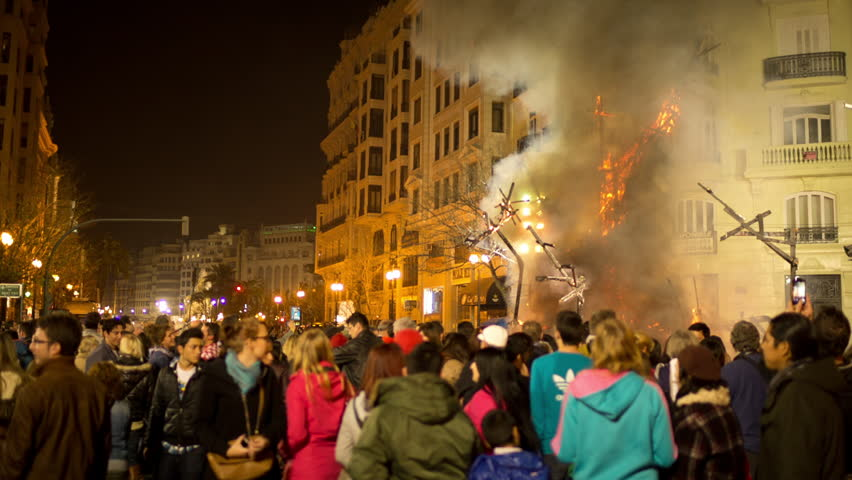 VALENCIA - MARCH 04: The final night of las fallas in valencia where the paper mache statues are burned. This huge fire festival lasts 2 weeks and attracts millions of tourists. 04 March 2014, Spain.