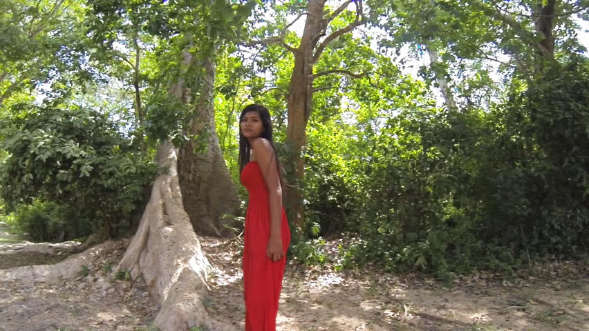 Beautiful  Cambodian girl turning around at slow motion in a forest. Recorded at 120fps