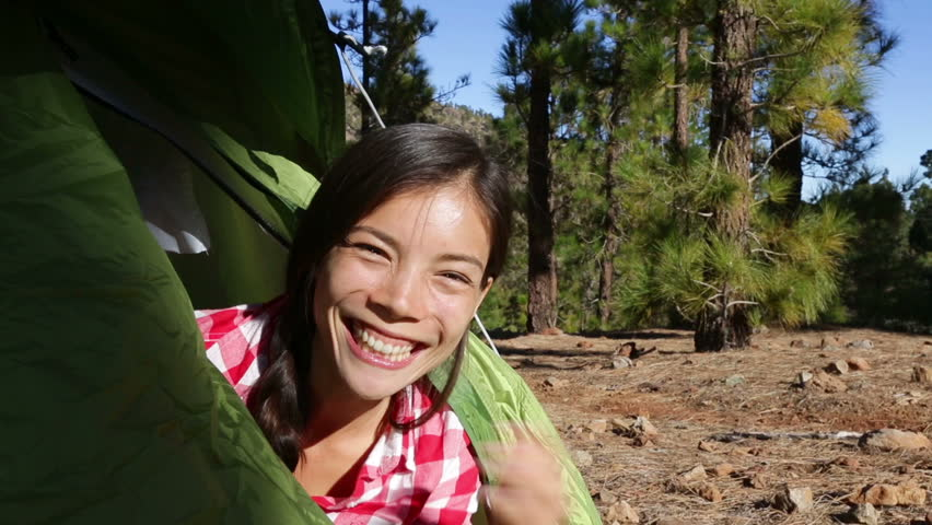 C&ing woman waving hello from tent smiling happy outdoors in forest. Happy girl saying hello and good morning opening tent. Smiling mixed race Asian ...  sc 1 st  Shutterstock & Camping Woman Waving Hello from Stock Footage Video (100% Royalty ...