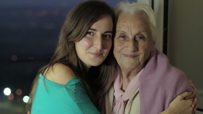 Granddaughter kiss her grandmother