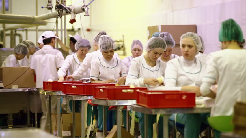 DOLGOPRUDNY, RUSSIA - MARCH 30, 2014: Stage of packing the product during ice-cream production at Pure Line dairy factory
