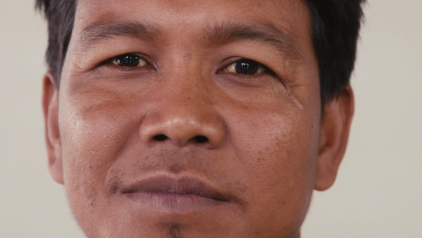Portrait of real Asian people, with emotions and feelings, looking at camera. Happy adult man from Cambodia, Asia smiling. Close-up of face, 30of56