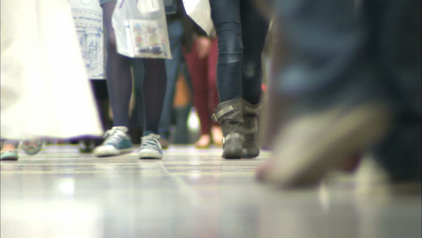 Anonymous shoppers feet and crowds of people in a busy shopping mall walking past camera. Shallow depth of field.  | Shutterstock HD Video #6227960