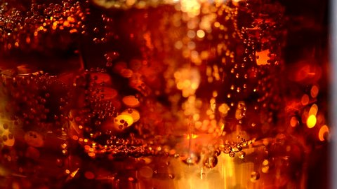 Cola background. Cola with Ice and bubbles in glass. Food background. Stock full HD video footage 1920x1080p