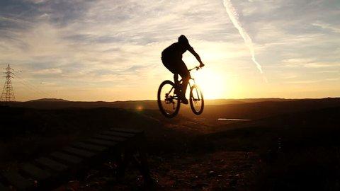Slow Motion Silhouette Mountain Biking Off Extreme Jump