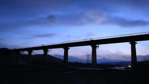 Steam train across the bridge in winter