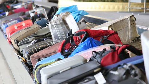 BANGKOK, THAILAND - MARCH 20, 2014: Baggage conveyor belt in the Suvarnabhumi Airport carrying the passenger luggage.