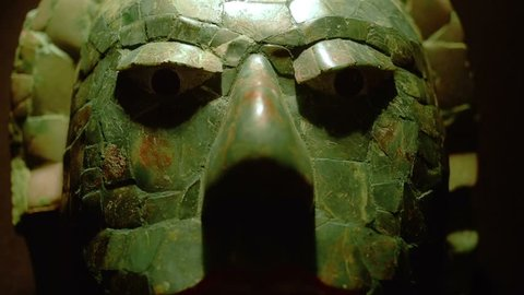 """MEXICO CITY, CIRCA JANUARY 2014: Detail of mask made in jade of a mayan warrior in exhibition """"Mayas Revelacion de un Tiempo Sin Fin"""""""