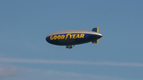 Ft. Lauderdale – February 24: Good Year striped Blimp flying over Pompano beach. February 24th, 2014 in Florida USA.