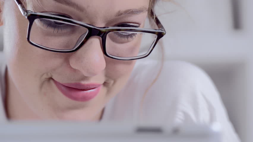 Attractive young blonde woman using tablet computer touchscreen. | Shutterstock HD Video #6355940