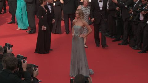"CANNES, FRANCE - MAY 2014: Rosie Huntington-Whiteley with shot of silk strapless Gucci gown on the red carpet for the premiere of ""The Search"" at the 67th Cannes Film Festival."