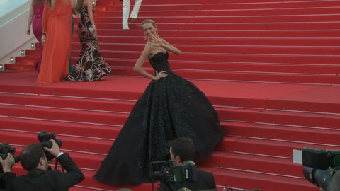 "CANNES, FRANCE - MAY 2014: Petra Nemcova on the red carpet steps, shot of black strapless Zuhair Murad gown, for the premiere of ""Deux Jours, Une Nuit"" at the 67th Cannes Film Festival."