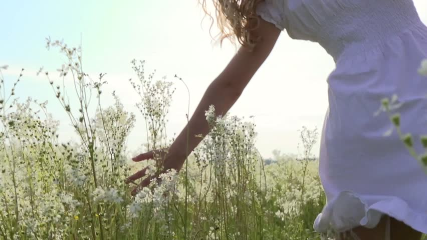 Beauty girl on spring or summer field running and spinning. Beautiful happy joyful young woman outdoors. Freedom concept. Slow motion video footage 1920x1080 full hd. High speed camera shot