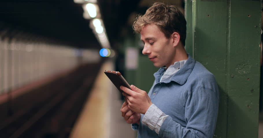Young caucasian man in New York City subway station platform using tablet pc computer | Shutterstock HD Video #6462950
