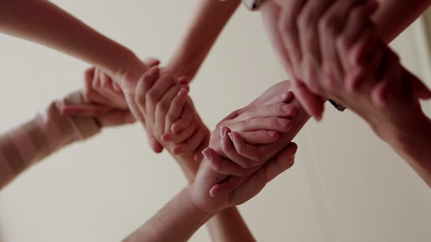 Many hands are connected greeting | Shutterstock HD Video #6491810