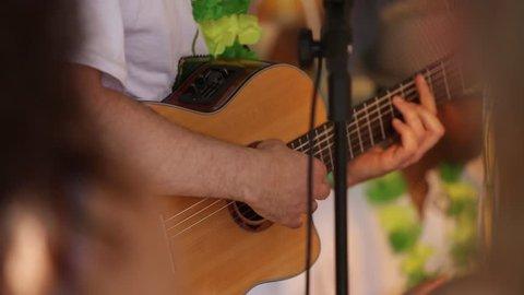 Guitarist playing samba at brazil party