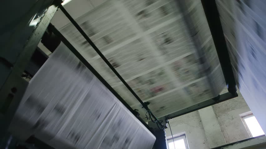 Printing machine, hit set speed roto offset print press, newspaper and magazine production industry. RAW video.