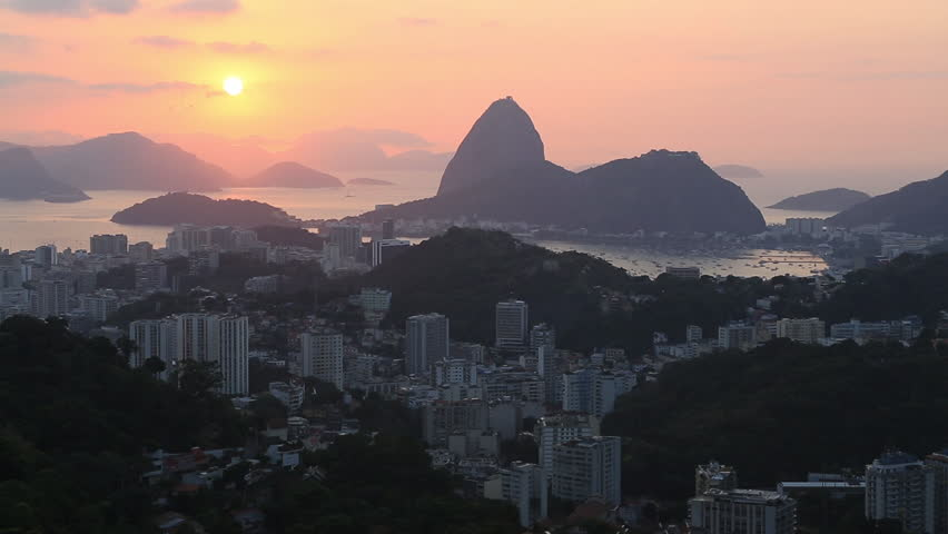 Wide shot of Sugarloaf mountain and the surrounding buildings in the city of Rio de Janeiro at sunset   Shutterstock HD Video #6514340