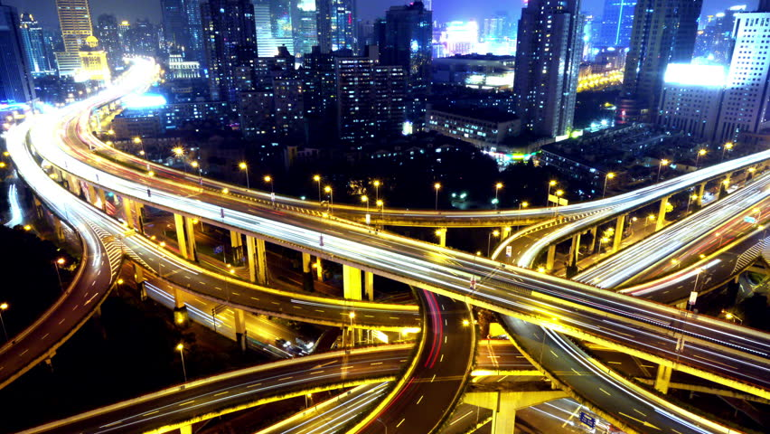 Timelapse of freeway busy city rush hour heavy traffic jam highway Shanghai at night,Yan'an East Road Overpass interchange,the light trails of traffic,Brightly lit urban morden building. gh2_07739_4k | Shutterstock HD Video #6521480