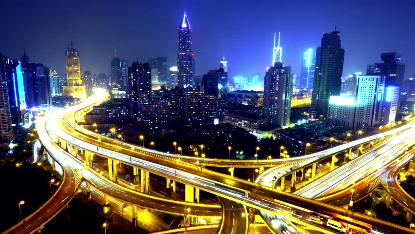 Timelapse of freeway busy city rush hour heavy traffic jam highway Shanghai at night,Yan'an East Road Overpass interchange,the light trails of traffic,Brightly lit urban morden building. gh2_07737_4k | Shutterstock HD Video #6552170