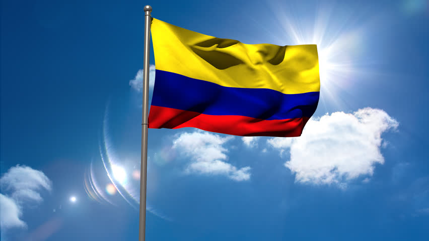 Colombia National Flag Waving On Flagpole On Blue Royalty Free Video