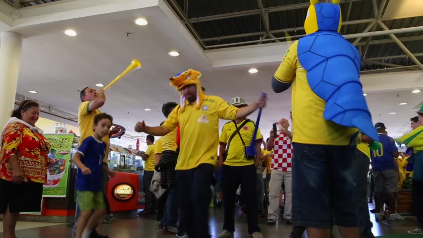 SAO PAULO, BRAZIL - CIRCA JUNE: Brazilian father and son dance samba before the match Brazil versus Croatia