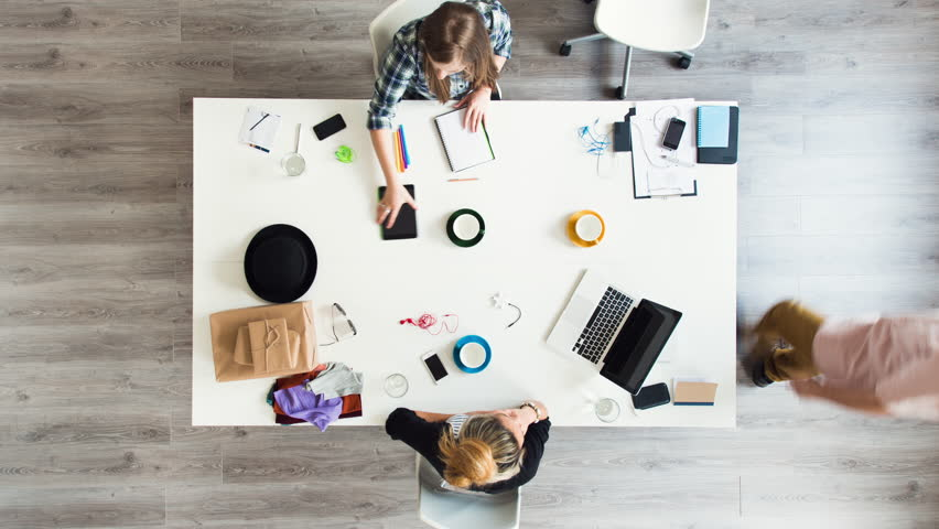 Mixed race group of people aerial view timelapse hipster office small business start up company planning creative meeting | Shutterstock HD Video #6604379