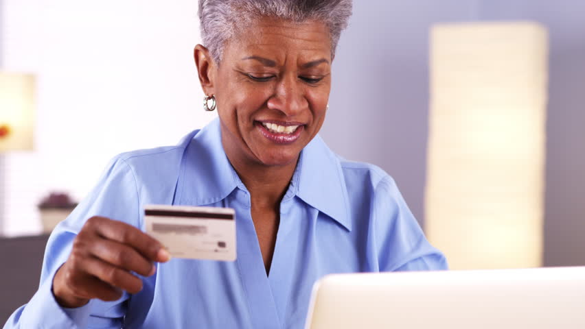 Happy Mature African woman buying things online | Shutterstock HD Video #6616130