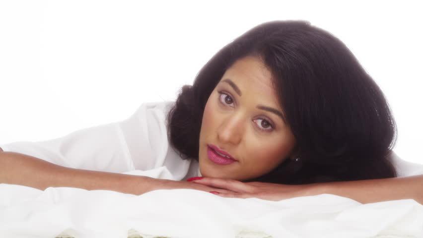 Hispanic Woman Lying On Bed Stock Footage Video (100%