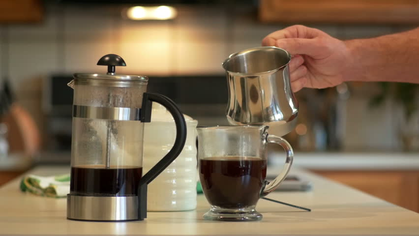 In A Domestic Kitchen Man Adds Milk To The Coffee He Has Made With French Press Slow Motion Footage Stock Video 6628700 Shutterstock