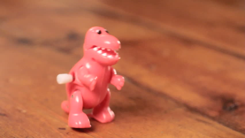 Classic toy dinosaur walking plastic wind-up t-rex