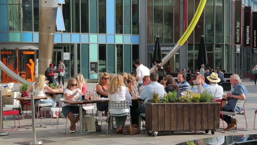 Cardiff South Glamorgan Wales May 18 2014 Unidentified People Enjoy The Weather At Restaurants And Cafes In Cardiff City Centre On A Summers Day