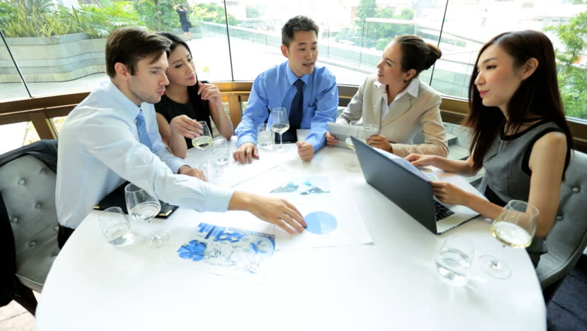 Asian Chinese Caucasian male female banking associates wireless laptop meeting downtown lunch restaurant | Shutterstock HD Video #6677450