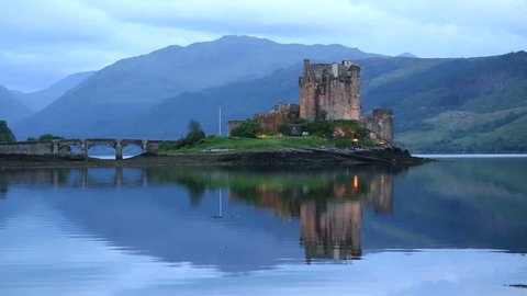 DORNIE, HIGHLAND/SCOTLAND - JUNE 09, 2014: Eilean Donan Castle on Loch Duich at twilight. The castle was founded in the 13th Century during the reign of Alexander II.
