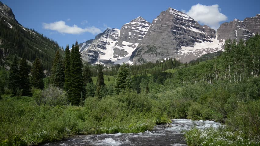 Maroon Bells and moving stream, Elk Mountains, Colorado, HD Video with Sound
