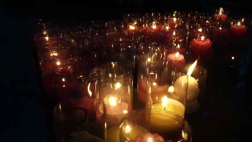 Candle light in the temple - HD stock footage clip