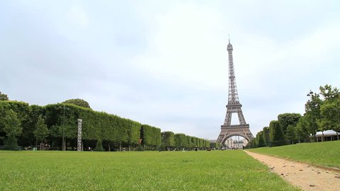 Eiffel tower tracking shot in summer, Paris, France. Find similar clips in our portfolio.