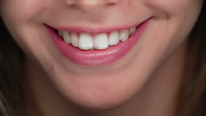 Extreme close up of female mouth smiling