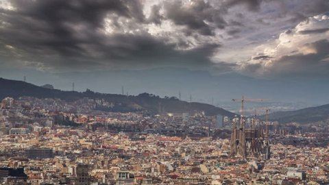 Barcelona skyline Sagrada Familia in distance with dramatic sky 4K UHD