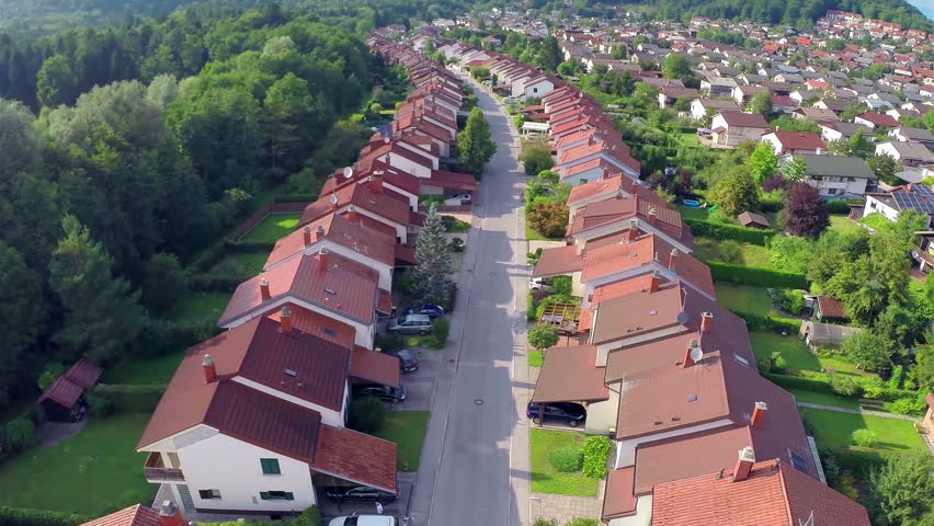 Aerial Flight Over Houses in Rows. Flying over suburban houses neighborhood at sunset.