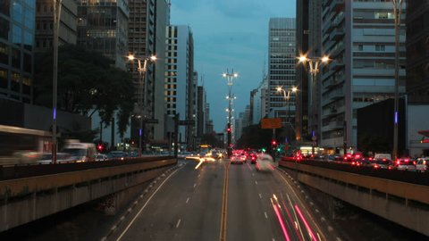 Rush hour after work on Avenida Paulista, Sao Paulo, Brazil - timelapse - day to night. Paulista avenue is one of the most important avenues in Sao Paulo.